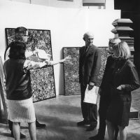 Alison Smithson (left), installing Painting & Sculpture of a Decade 54-64 exhibition, Tate Gallery, London, 1964. Photo by Bryan Hesseltine. Smithson Family Collection.